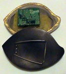 brown brooch open small
