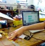 Yann Seznec testing narrow knitted stretch sensor in Ableton